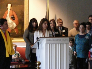 Rep. Pam Tucker opens press conference on HB 370; Dominique Vazquez-Vanasse in right foreground