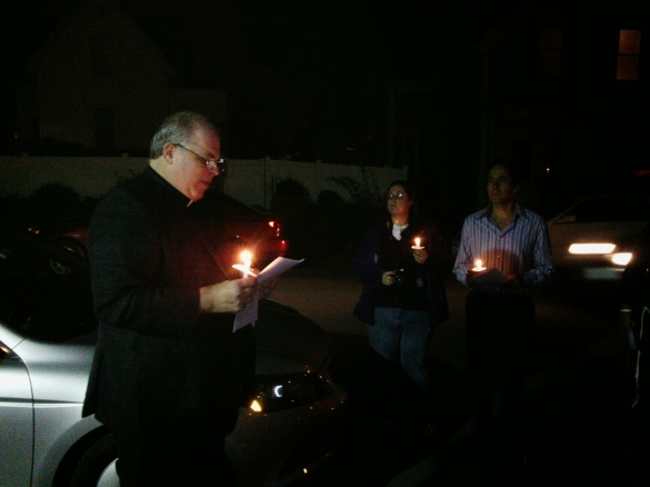 Pastor Colageo of Immanuel Lutheran Church, Manchester, reading from Psalms at 40DFL vigil. E. Kolb photo.
